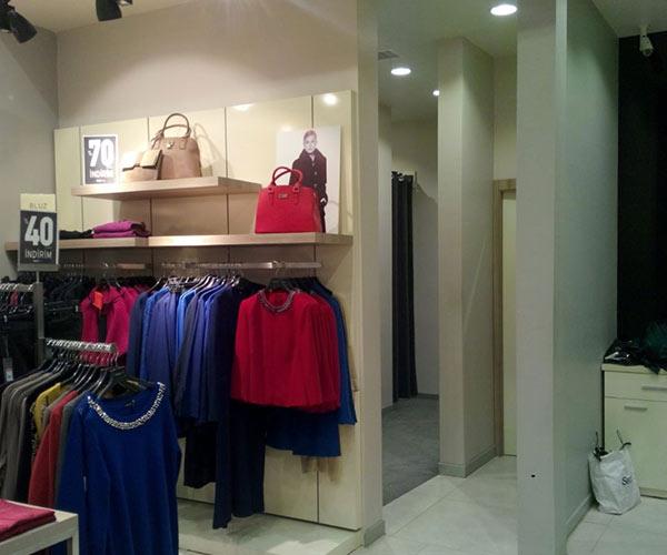 giyim mağazası raf tasarımı tekstil mağaza dekorasyonu